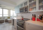 Sleek Greige Kitchen With Pops Of Red